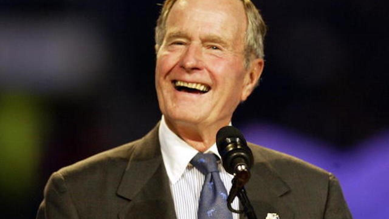 Former President George H.W. Bush is alert and talking, but remains in intensive care