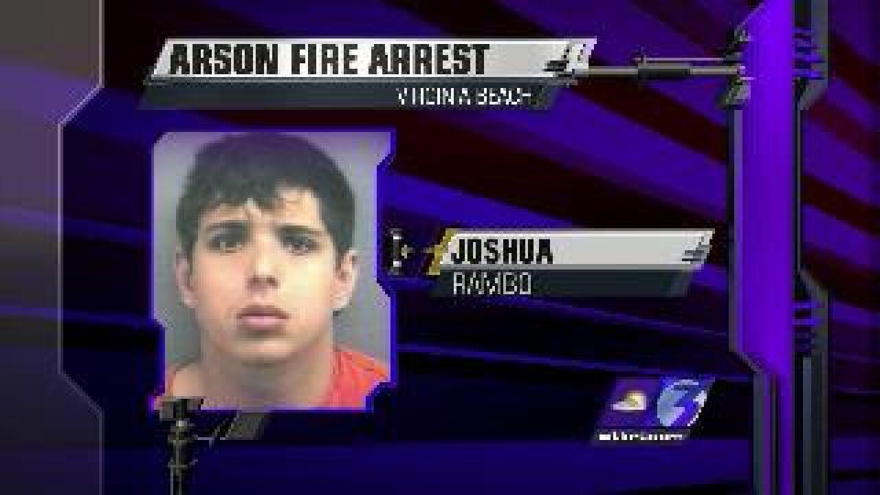 Man accused of setting neighbor's house on fire
