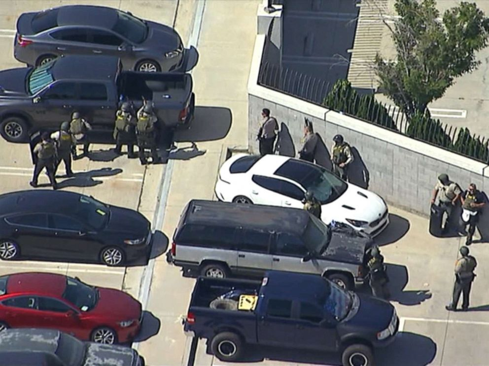Police on the scene where a sheriff's deputy was shot heading to his car in a parking lot in Lancaster, Calif., Aug. 21, 2019 (KABC).