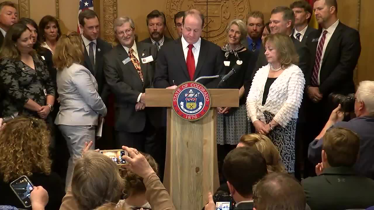 jared polis signs sb181 oil and gas bill.png