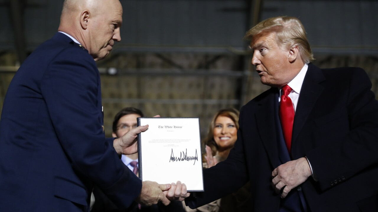 With a signature, Trump brings Space Force into being