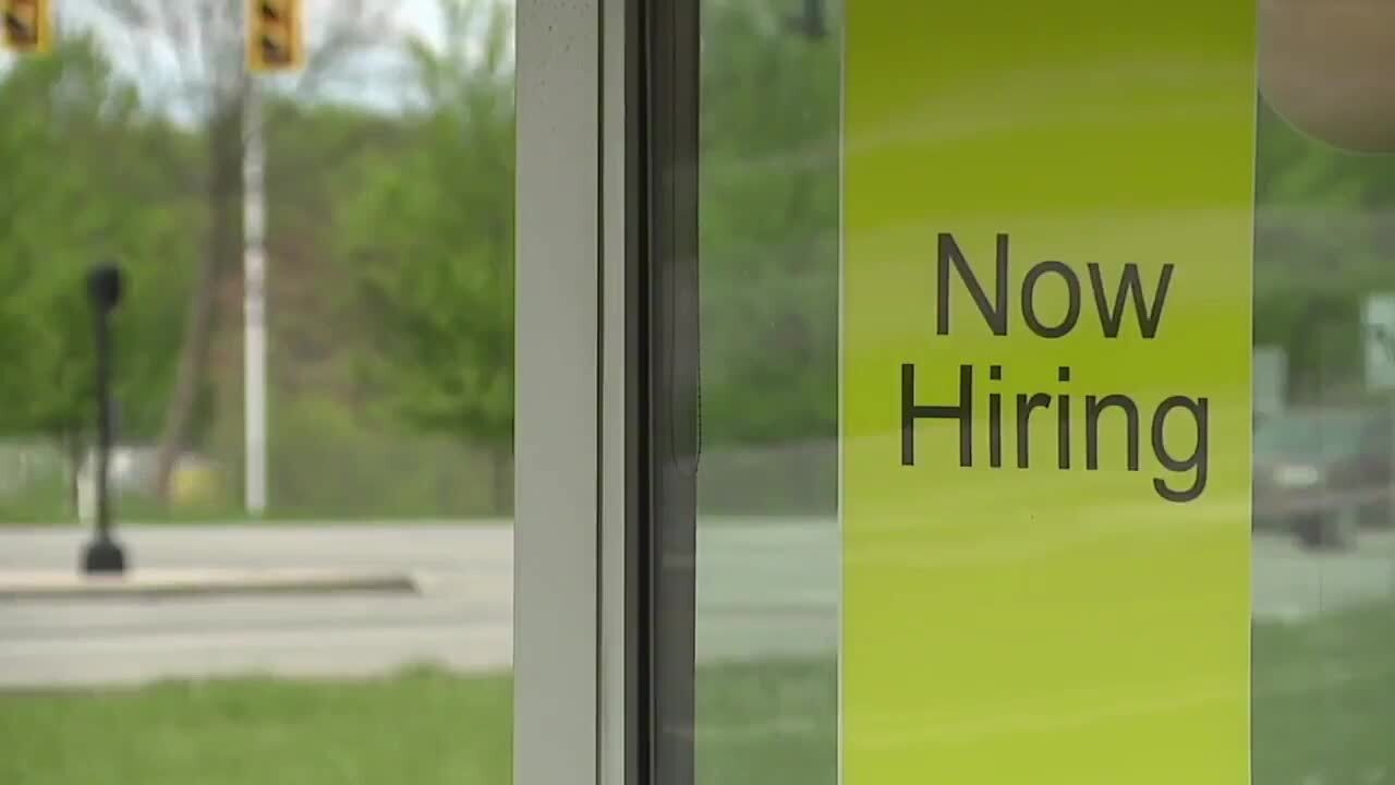'Now Hiring' sign outside business in Tallahassee