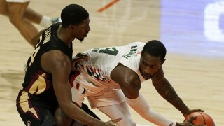 Florida State Seminoles guard Sardaar Calhoun defends against Miami Hurricanes guard Elijah Olaniyi, Feb. 24, 2021