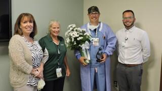 Sparrow Ionia Hospital Nurse Justin Thomas displays his DAISY award for extraordinary nursing after a recent ceremony.