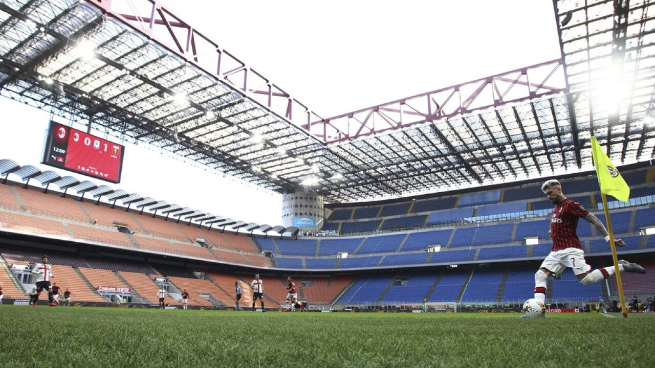 AC Milan's Samu Castillejo kicks from the corner in an empty stadium during the Serie A soccer match between AC Milan and Genoa at the San Siro stadium, in Milan, Italy, Sunday, March 8, 2020. Serie A played on Sunday despite calls from Italy's sports minister and players' association president to suspend the games in Italy's top soccer division. (Spada/LaPresse via AP)