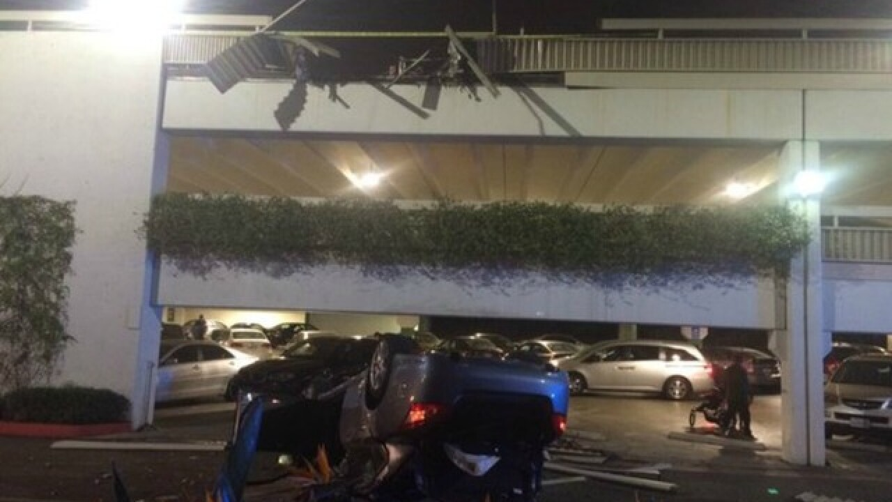 Car nosedives off California mall parking garage