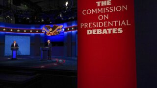 What is poll watching and why did it become an issue during the debate?