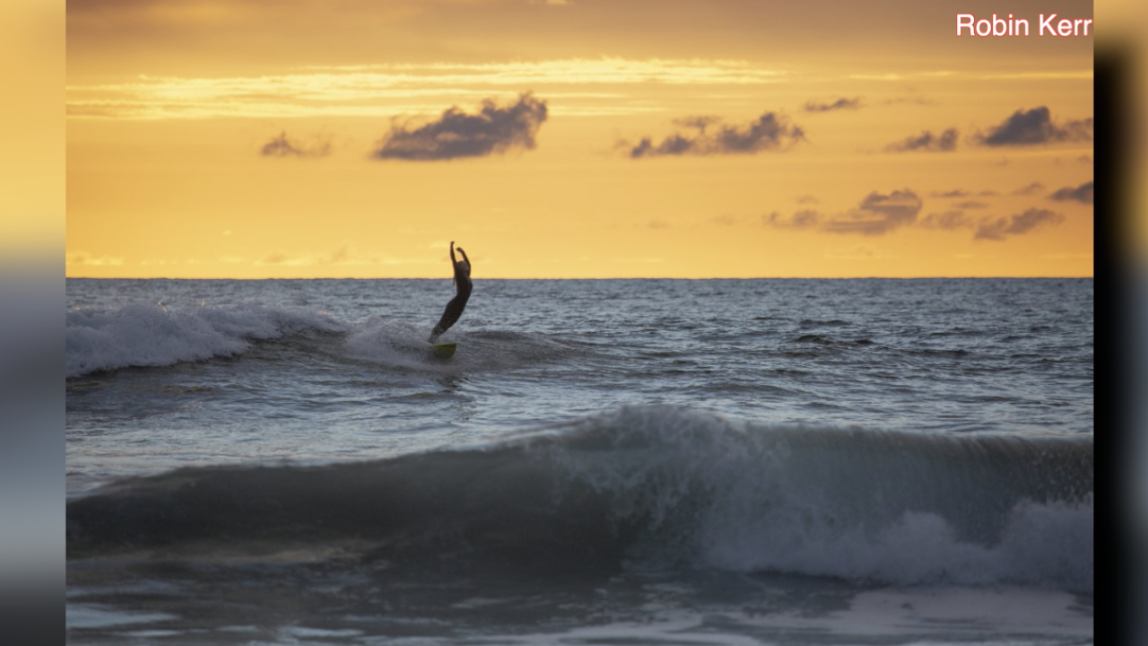 Photographer searching for female surfer in photo