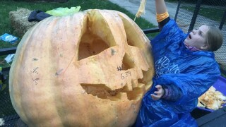 Dearborn family carves giant pumpkin in preparation for Halloween