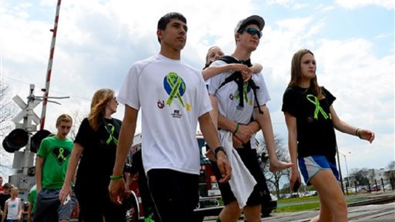 On 6th day, teen carrying brother reaches Michigan Capitol