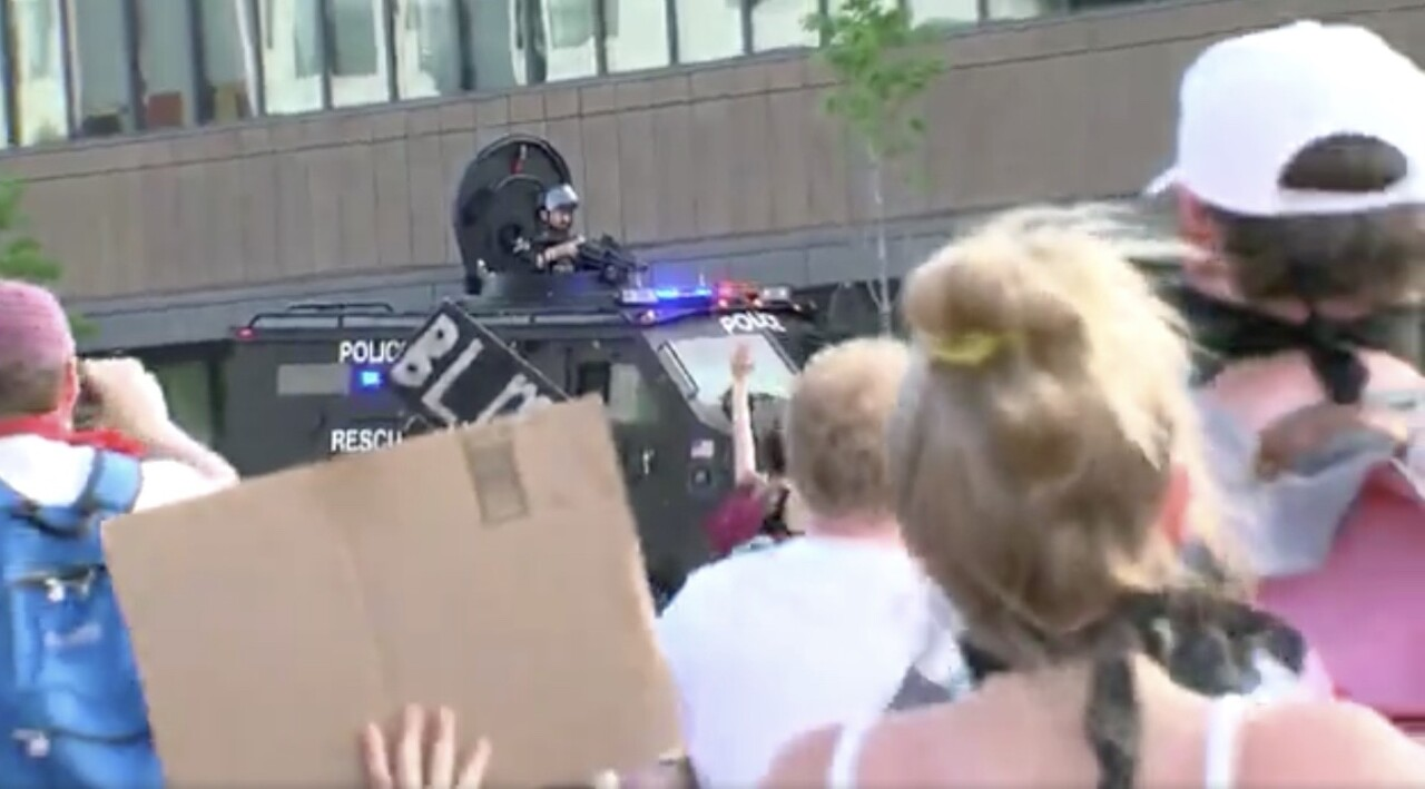 police officer protesters tear gas milwaukee