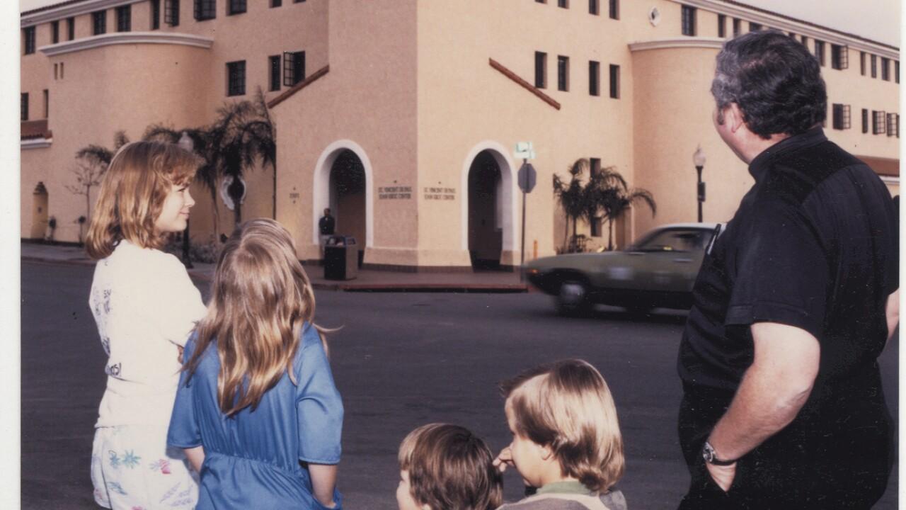 father joe carrol kids in front of JKC.jpg