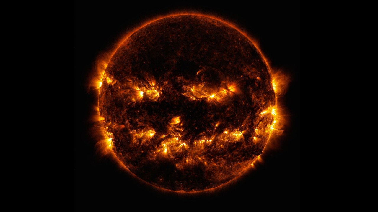 NASA on Sunday shared a photo on Facebook and Twitter of the sun looking a lot like a giant flaming jack-o'-lantern.