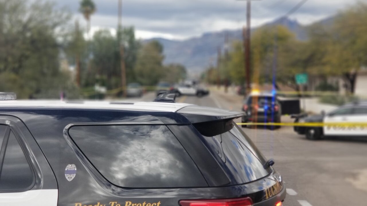 Tucson police vehicle in front of blurred crime scene