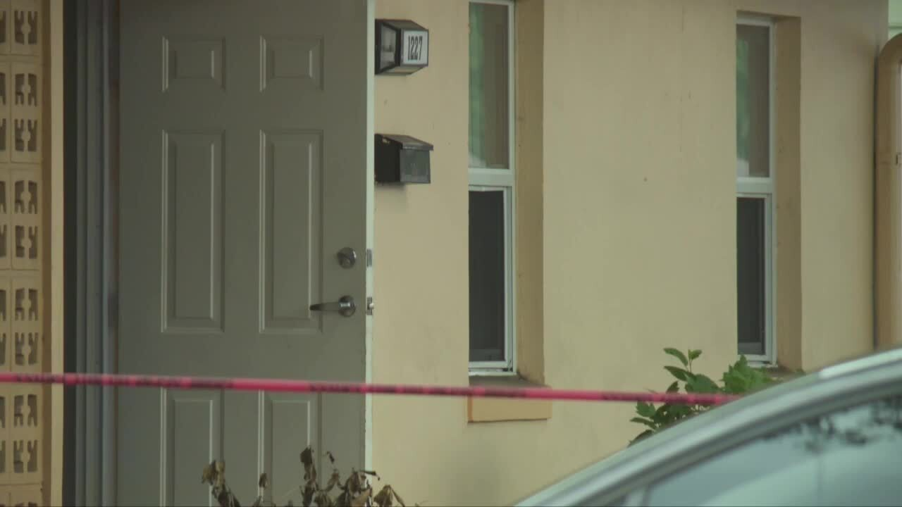 crime scene tape outside home where 15-year-old went after being shot in mouth
