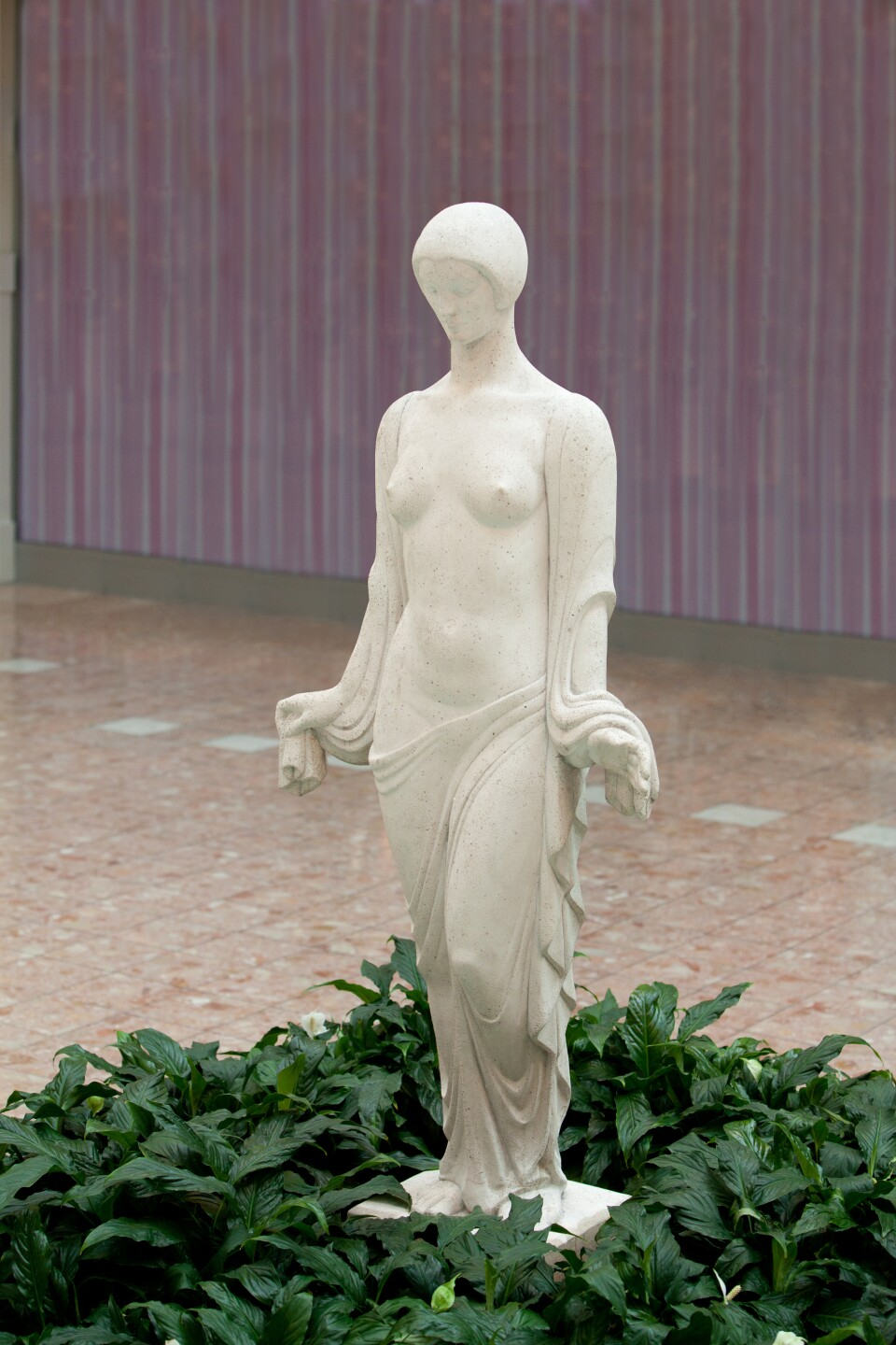 Maya by Wheeler Williams – a stone cast sculpture originally created for the artist's garden, offering serenity through its grace and elegance.