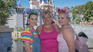 Tamia Robinson, center, enjoys her trip to Disneyland in August 2019.
