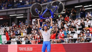 Italy sets world record in team pursuit cycling to stun Denmark