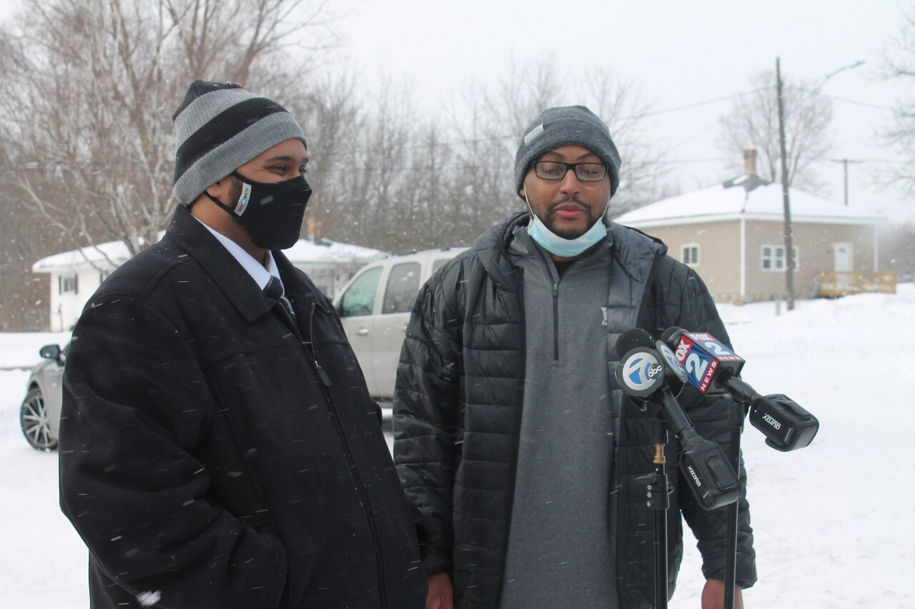 WMU-Cooley Innocence Project Staff Attorney David Williams (left) with Kenneth Nixon during a media briefing. Nixon was released after being wrongfully convicted of murder, attempted murder and arson in 2005