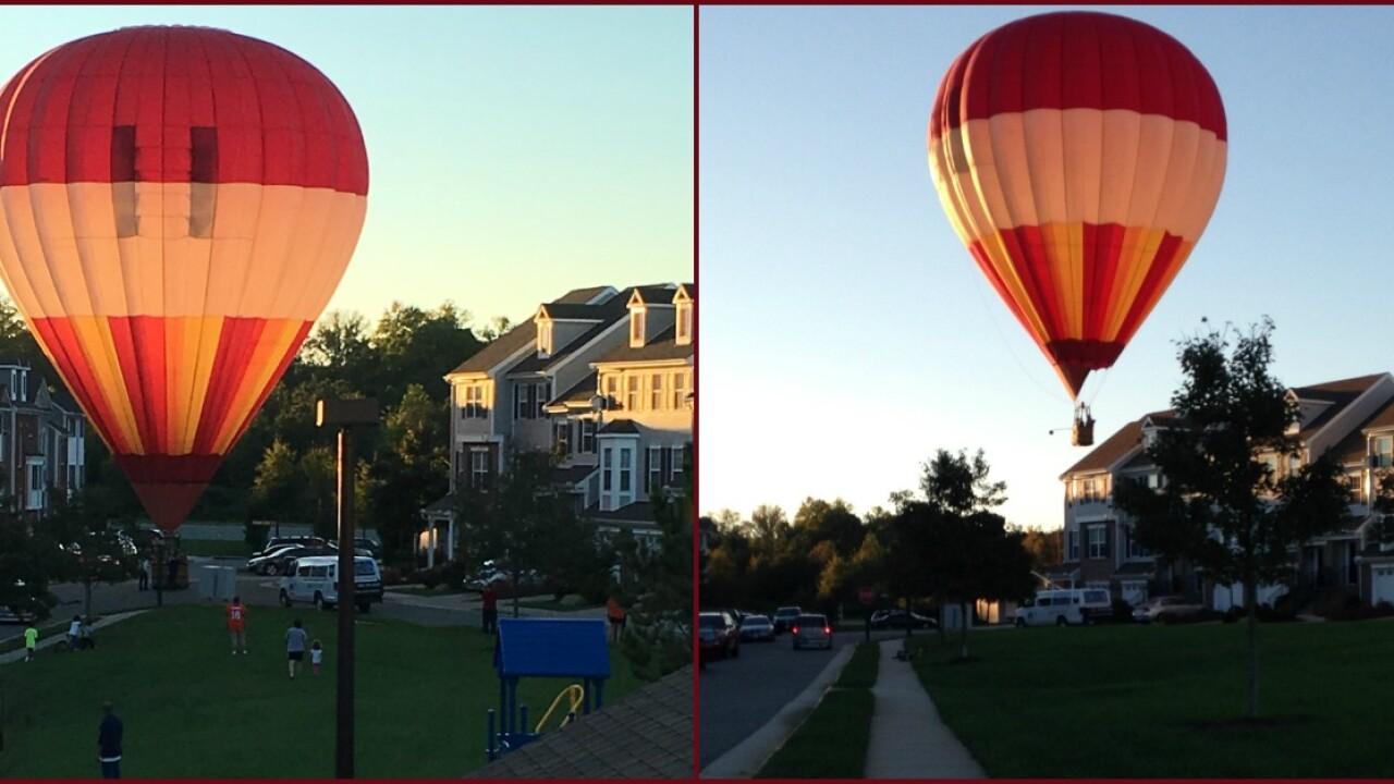'Please don't crash!' Hot-air balloon makes surprise landing inneighborhood