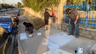 Police encounter leads to 'redemption' for men who spray-painted messages aimed at racial injustice