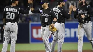 Rockies hit 3 home runs to beat winless Padres 7-4