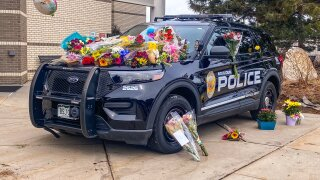 Boulder Police Department vehicle with flowers_Boulder King Soopers shooting
