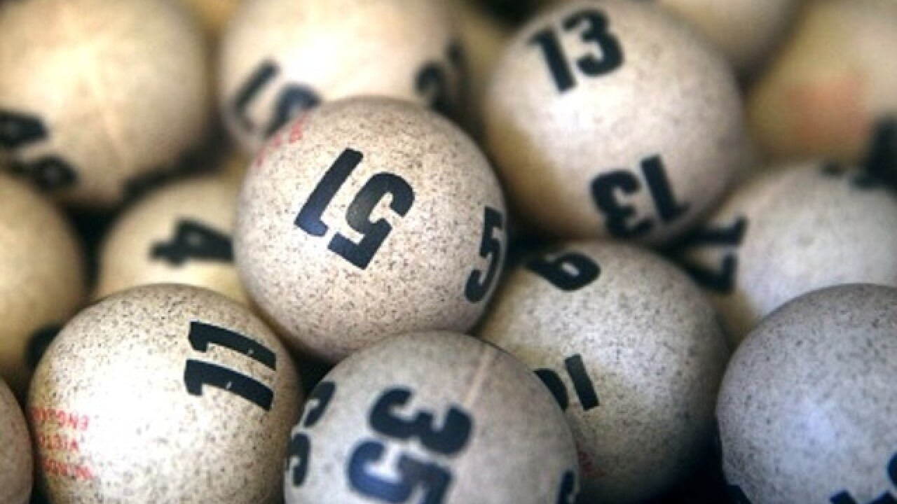 Wisconsin officials file charges in lottery fixing scheme