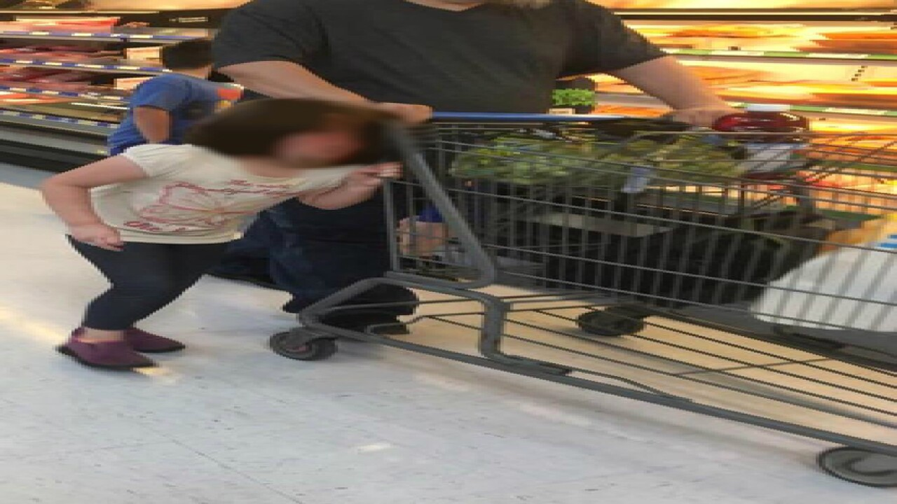 Photo: Man drags girl around Walmart by hair