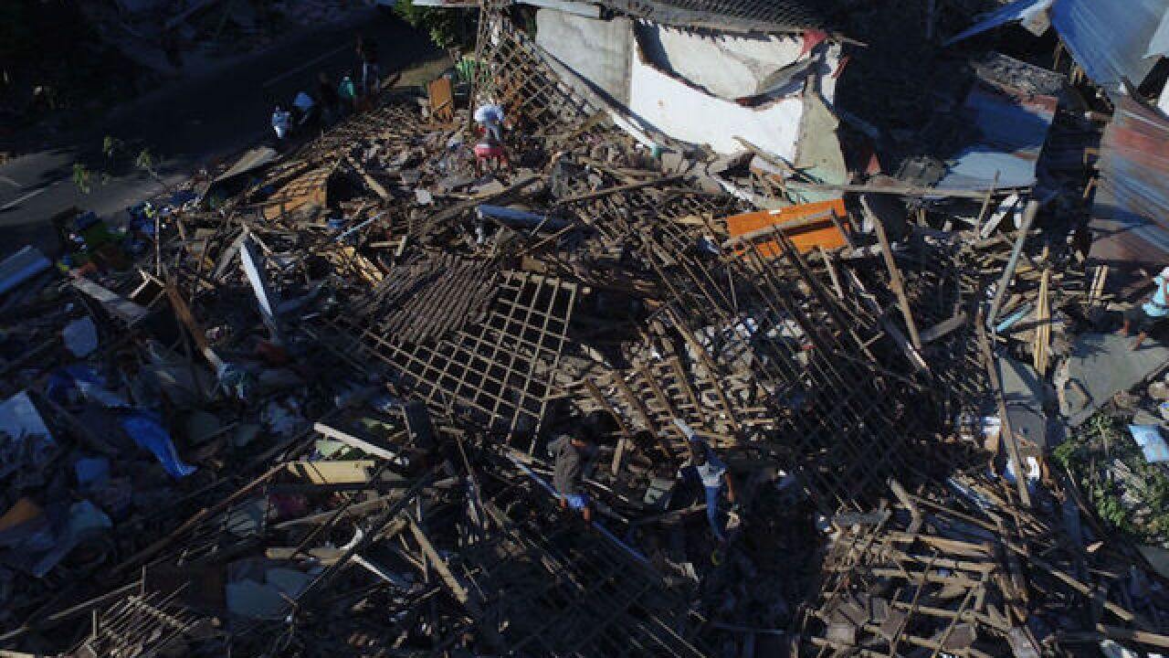 Lombok earthquake death toll rises to 105 amid search for survivors
