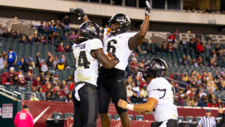 UCF Knights Bentavious Thompson celebrates with Marlon Williams