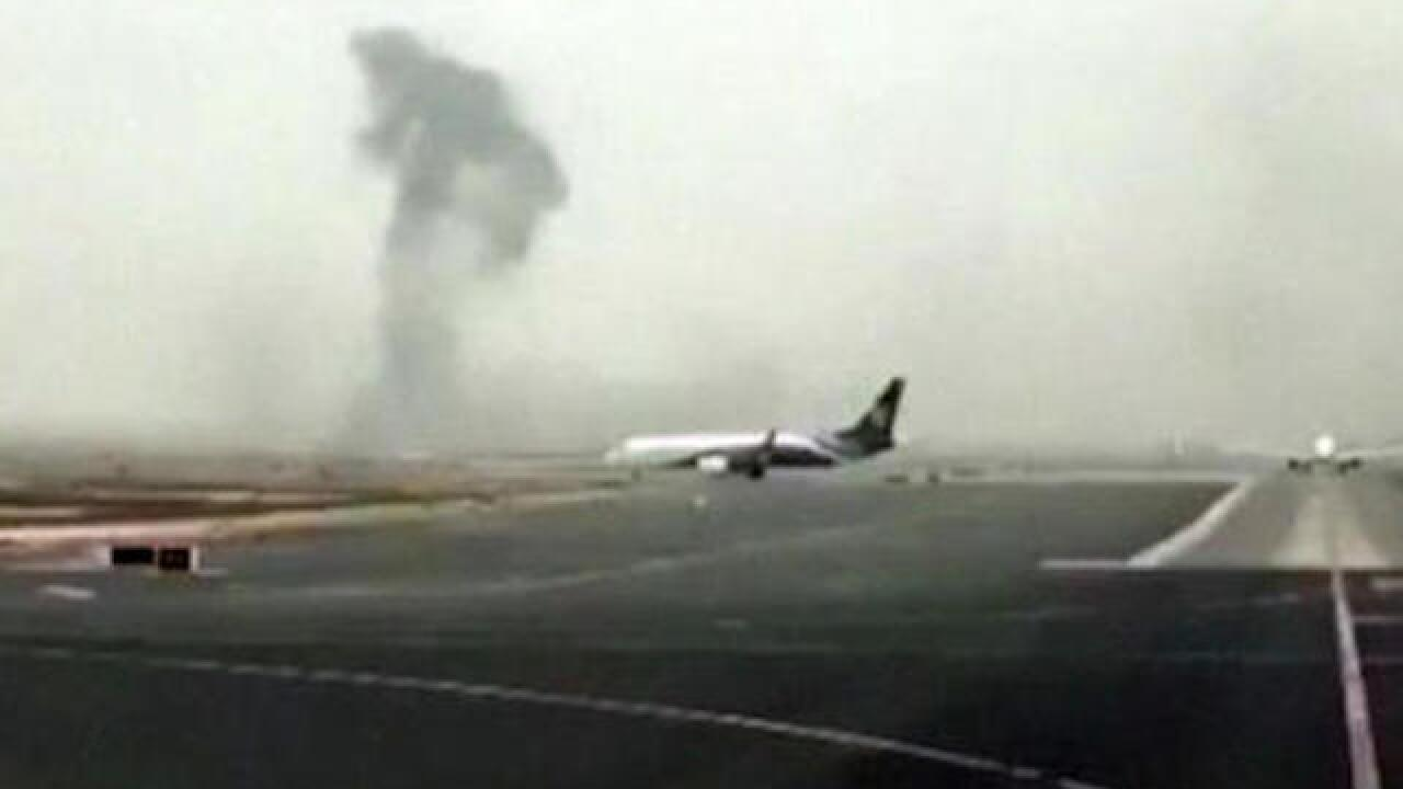 Smoke seen coming from plane at Dubai airport