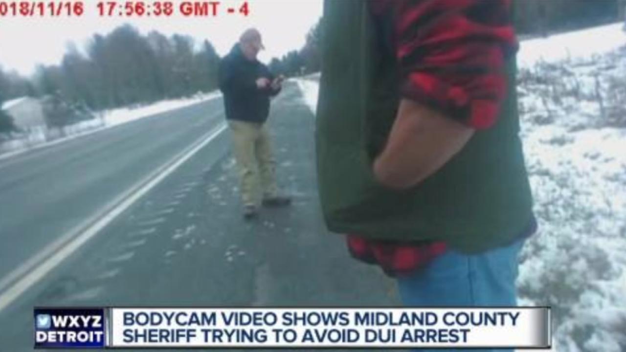 Bodycam video shows Michigan sheriff trying to avoid drunken