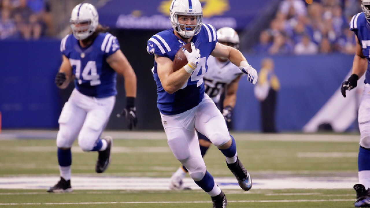 Luck, Hilton hook up to rally Colts past Chargers 26-22