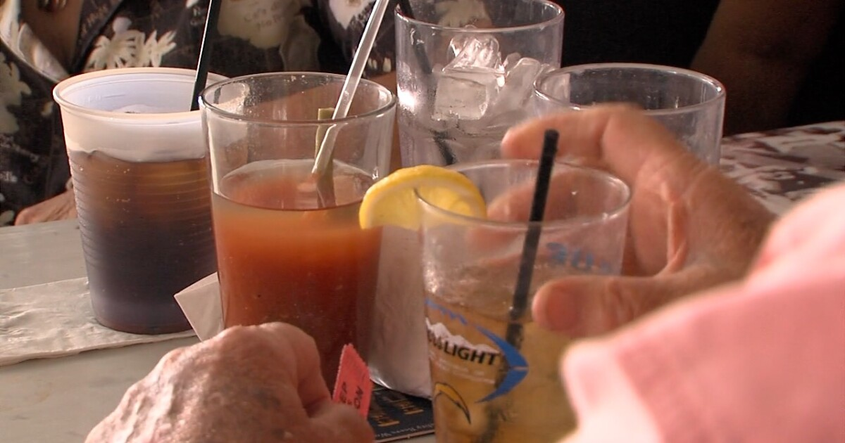 Study: Forcing a smile at work could lead to heavy drinking