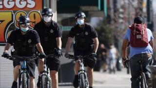 Denver Police Department bicycle patrol in face masks, r m