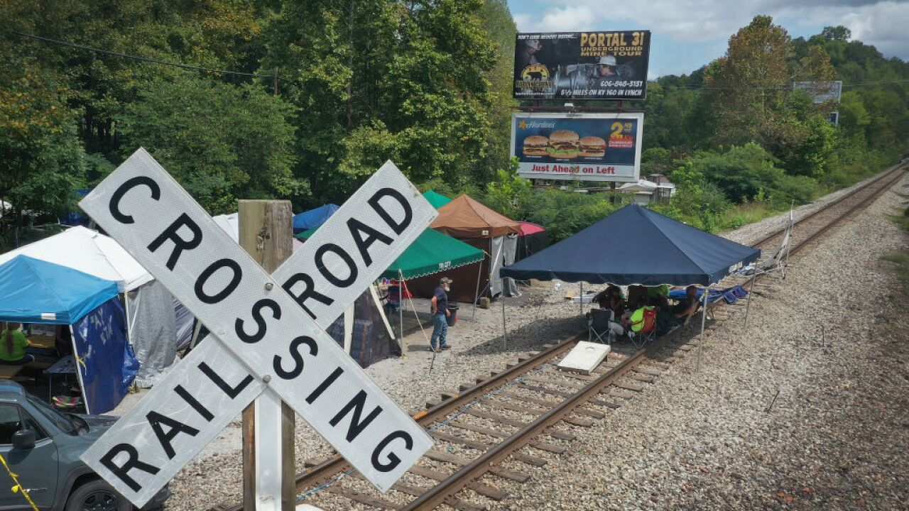 Kentucky miners, still seeking back pay, end coal train protest after 2 months