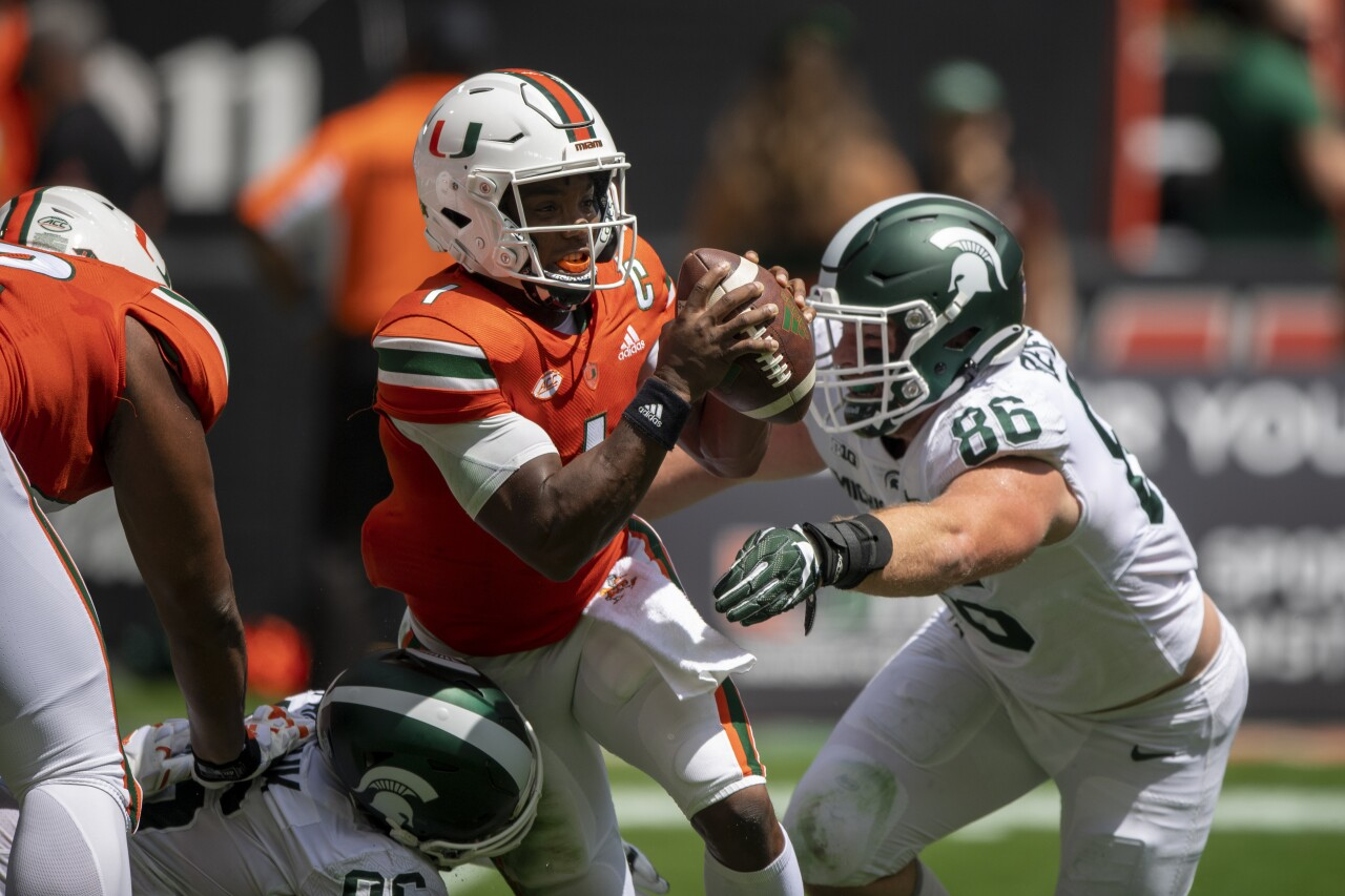 Miami Hurricanes QB D'Eriq King pressured by Michigan State Spartans defensive end Drew Beesley in 2021