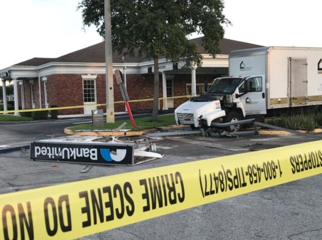 PHOTOS: Large truck crashes into suburban West Palm Beach ATM