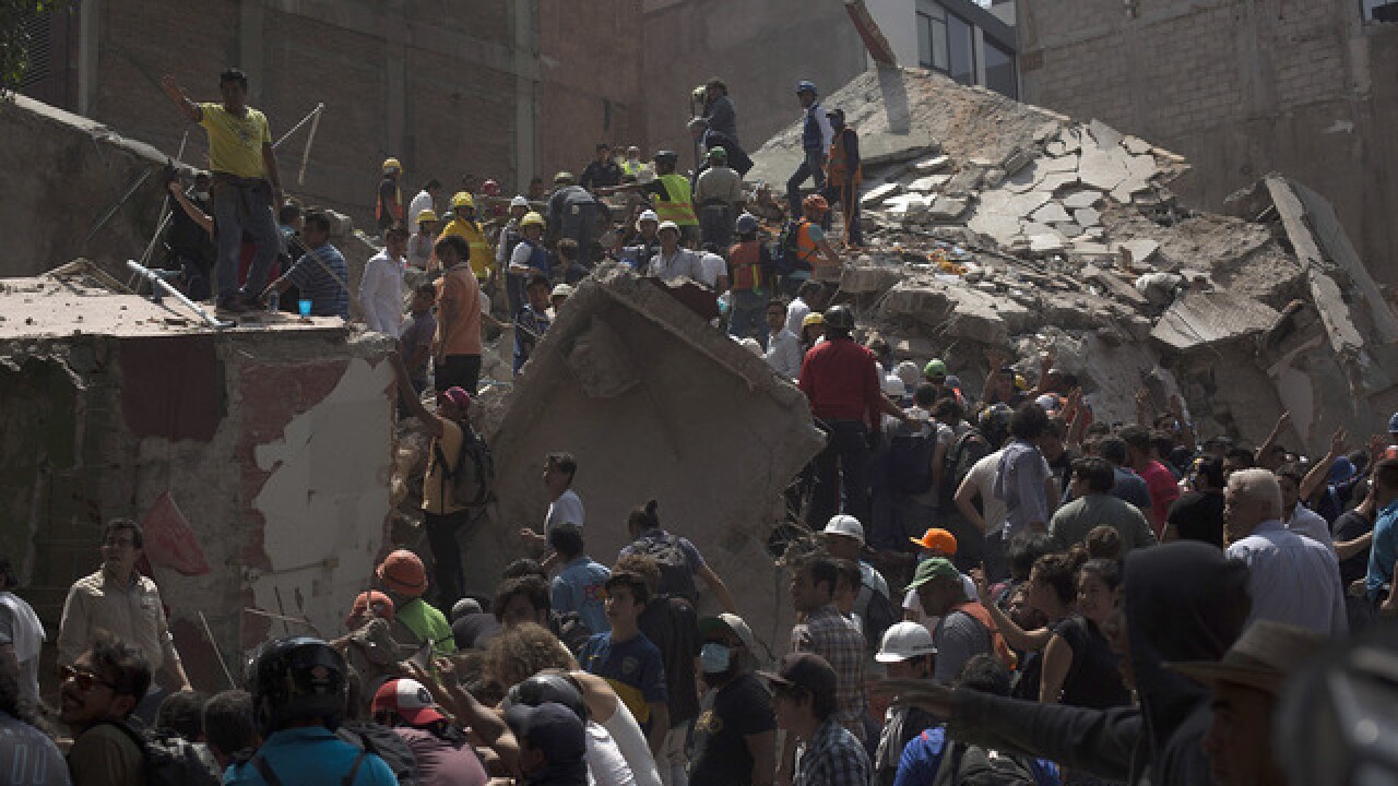 Mexico quake rescuers struggle to free girl, other survivors
