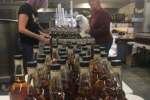 Katrina-Lucier-and-Pauline-Miller-bottlers-at-Montgomery-Distiller-263x350.jpg