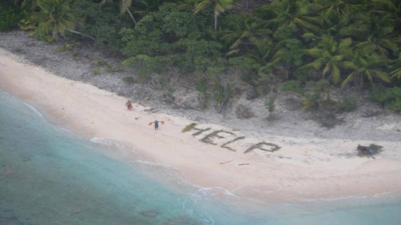 Shipwrecked mariners signal to plane for help
