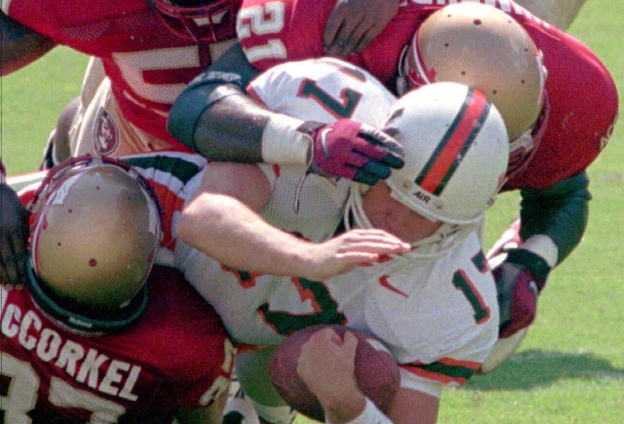 Florida State Seminoles tackle Miami Hurricanes kicker Andy Crosland in 1997