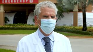 Dr. Sergio Segarra, chief medical officer of Baptist Hospital in Miami, speaks to WPTV on Sept. 9, 2021.jpg