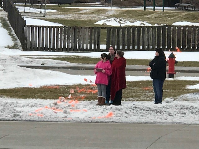 This family pulled over to the side of the road to pay their respects as the procession route began to form.