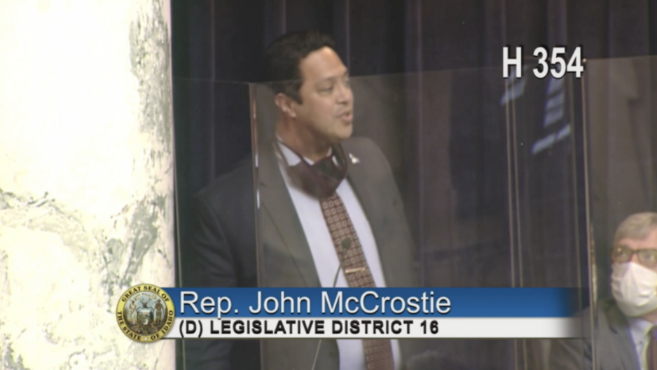 Rep. John McCrostie speaks in front of Idaho House