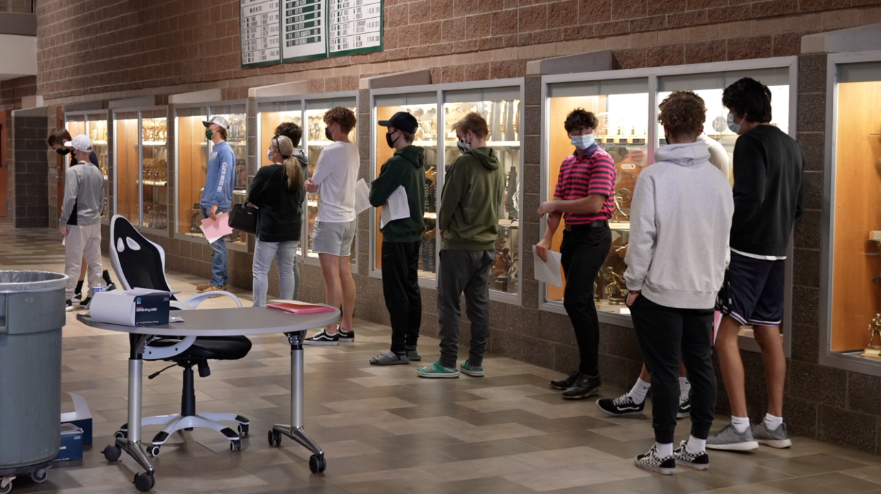 Students line up at Williamston High School to get tested for COVID-19