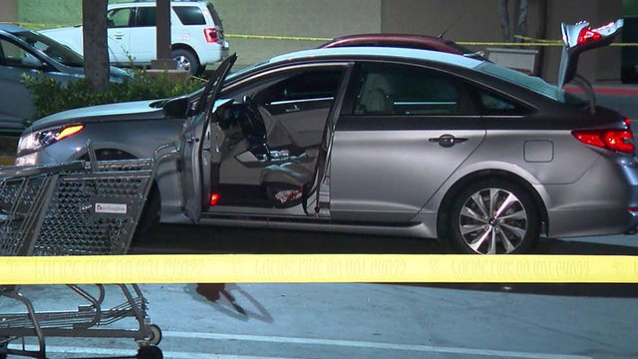 Man shot, killed in shopping center parking lot