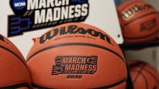 2020 March Madness logo and basketballs