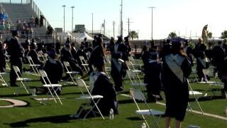 STUDENTS KNEELING collegiate graduation 0605.jpg